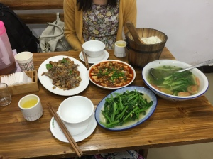 Lisa and I: A feast with 麻婆豆腐 (the red dish in the middle)